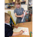 Nursery children busy mark making.