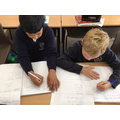 Year 3 writing a report about Ancient Egypt.