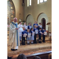 Father Sean presenting certificates in Mass...
