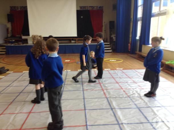Working out coordinates on the Maths mat.