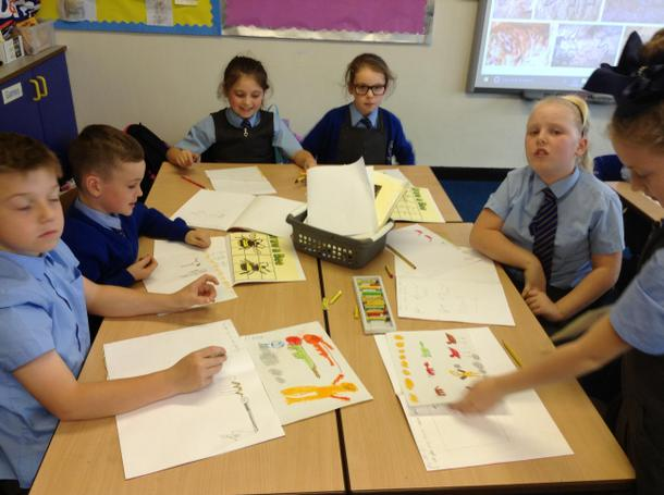 Creating Stone Age cave paintings using pastels.