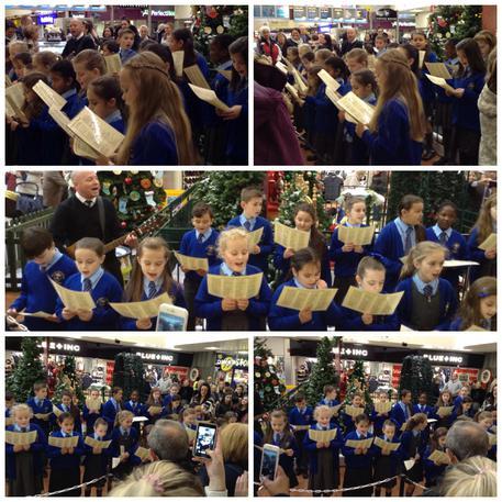 Choir singing in Belle Vale Shopping Centre.
