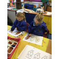 We collaged 'The Three Little Pigs' houses.