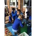 This morning, we adapted storage containers to become drums!