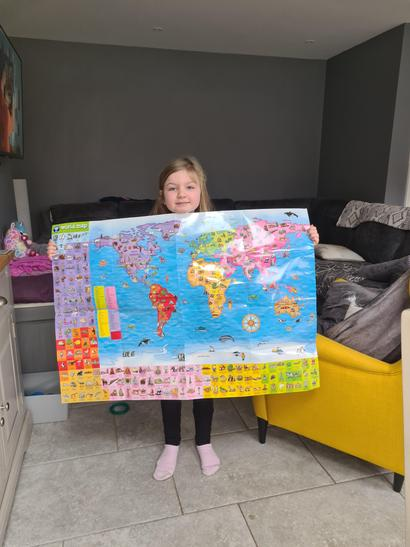Gracie and her giant map of the worlds continents.