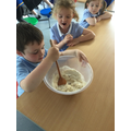 On Wednesday, we mixed together the ingredients to make bread.