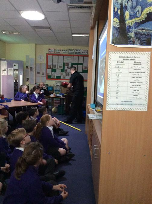 Fire officer tells the class how they can save someone in the river.