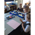Creating our own song and beat about the people who help us.