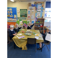 Children sat at their tables ready to eat.