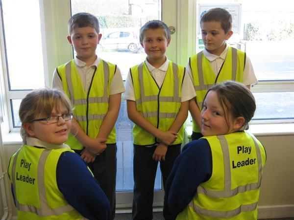 The Play Leaders wear bright yellow jackets