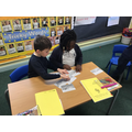 Sorting pictures of the story into order.
