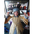 Dressing up as a Tudor girl.