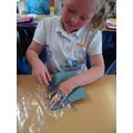 Preparing our plastic bag.