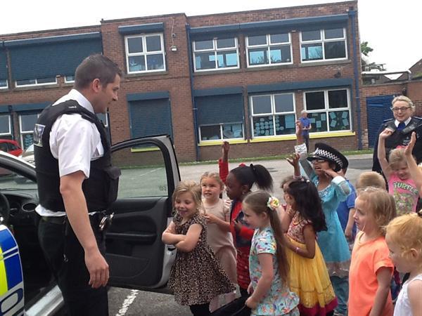 Having fun in the Police car.