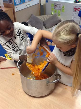 Putting onion and pumpkin in the pan.
