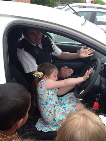 Having fun in the Police car.