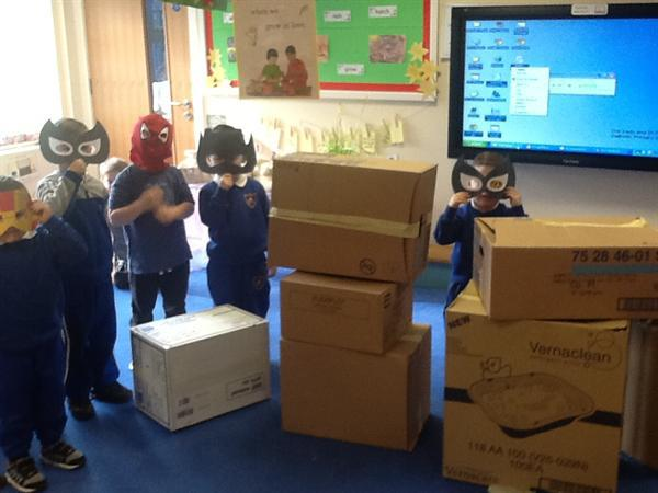 We made a superhero city using boxes and material.