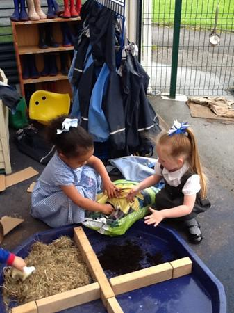 We have made a farm outdoors and in our class.