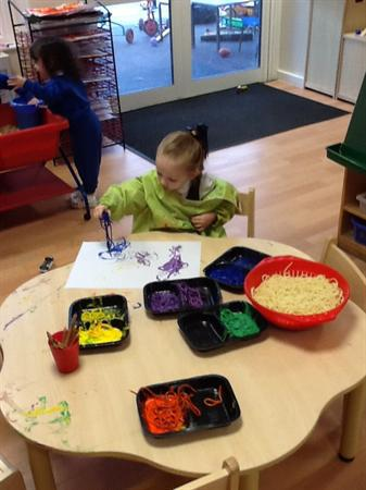 We painted beautiful pictures using spaghetti.