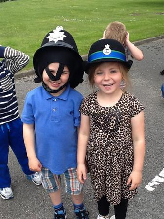 Trying on the Police hats.