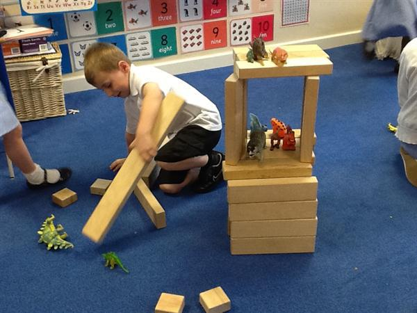Building dinosaur homes.