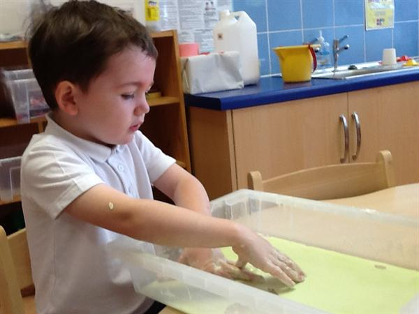 We have been practicing writing in slimy cornflour