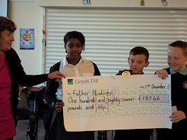 Donating our cheque to the Father Hudson's Society