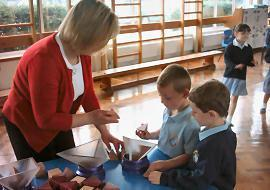 Mrs Allen helping 'packing and stacking' activity