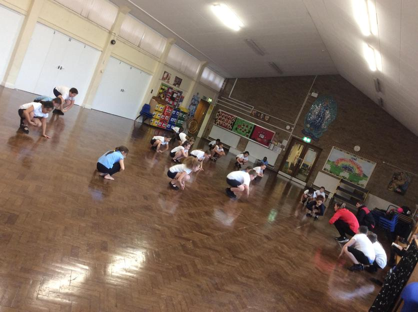 Year 4 practising their routine as part of their PE dance unit.