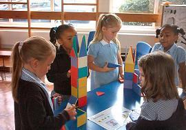 Children making castles with 'magnetiles'.