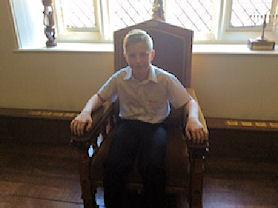 Sitting in the Pope's chair.