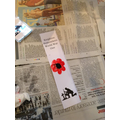 Children made finger print poppy bookmarks