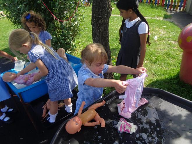 Washing our doll's clothes.