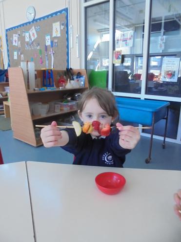 Making and eating healthy fruit skewers