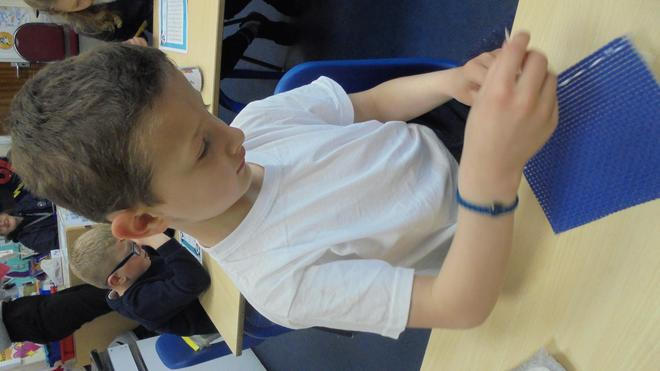 In DT we practised our sewing skills.