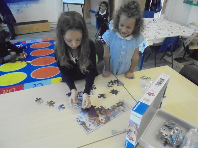 Completing puzzles.