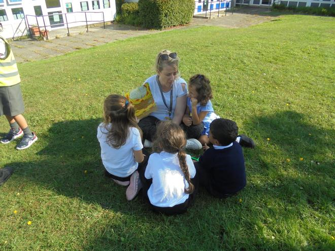 Enjoying a story in the sunshine.