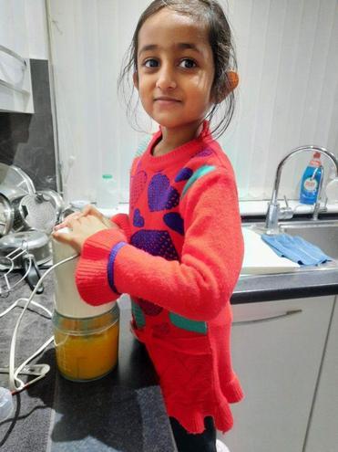 Dhyani making orange juice