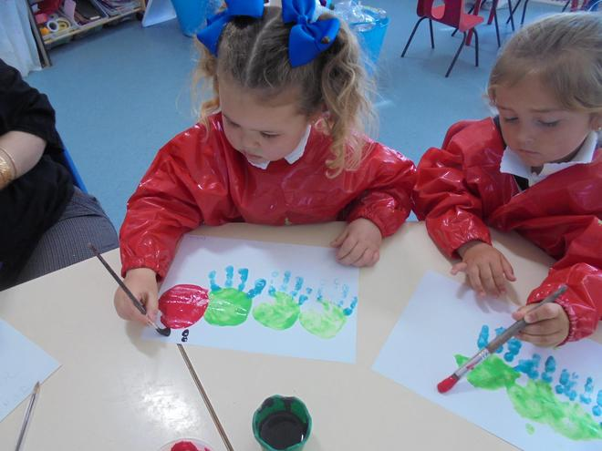 Handprints and painting a caterpillar