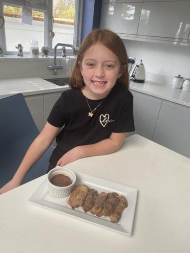 Olivia's Churros with chocolate sauce