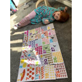 Lottie completing a HUGE number jigsaw.