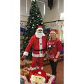 Santa with his helper, Mrs Walsh.