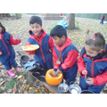 Making Pumpkin soup in the mud kitchen