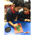 We made Christmas cards using different resources
