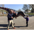 Giving Sophie the T-Rex a stroke.