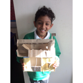 Faraaz Khan with his homemade Tudor house