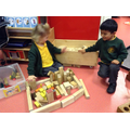Making a house using shaped bricks and talking about them.