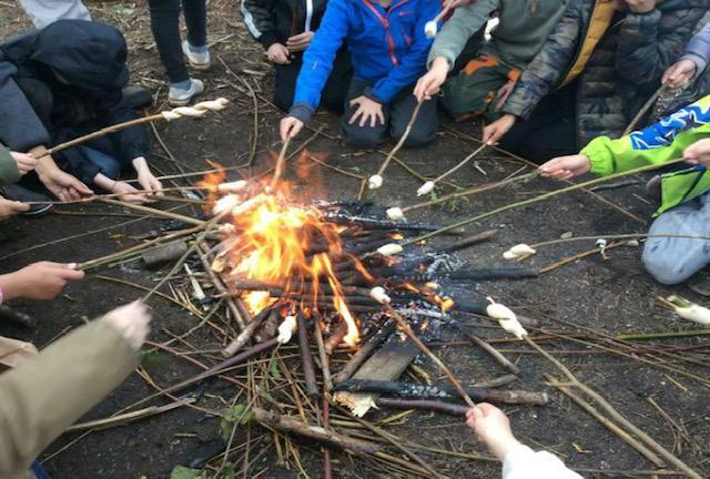 Cooking over a camp fire during Stone Age Day