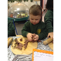 Making play-dough gingerbread men