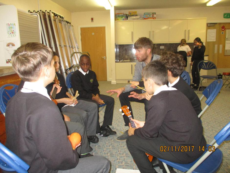 Y6 developing their ukulele skills.